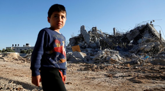 A boy walks past the rubble of a Palestinian house after it was demolished by Israeli troops in the West Bank village of Qalandia near Ramallah July 26, 2016. © Mohamad Torokman / Reuters